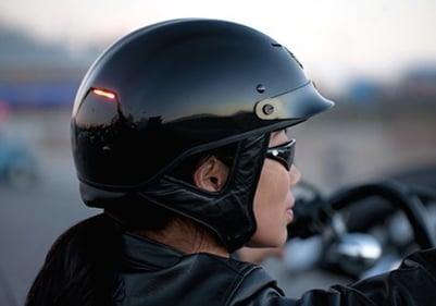 woman wearing a harley davidson half motorcycle helmet