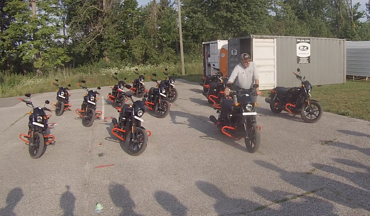 A Harley Davidson Riding Academy coach demonstrating how the front brakes of a motorcycle operate.