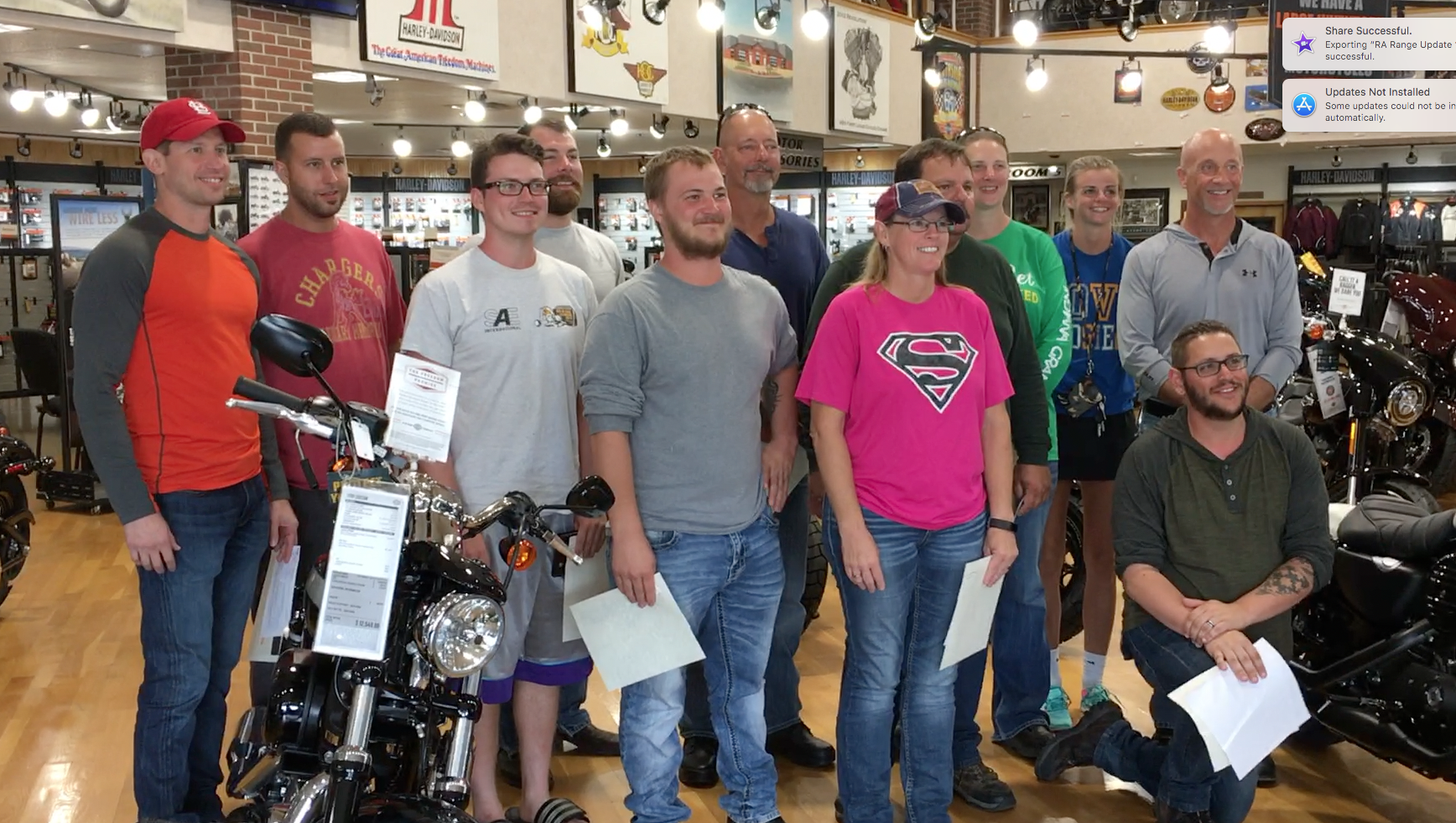 A group of Harley Davidson Riding Academy students posing for a photo after graduating the class.