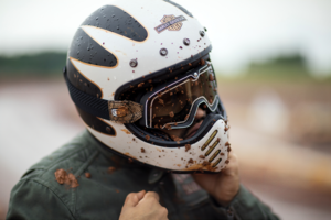 man wearing a dirty harley davidson motorcycle helmet