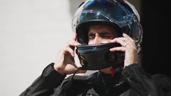 man wearing a harley davidson full face helmet